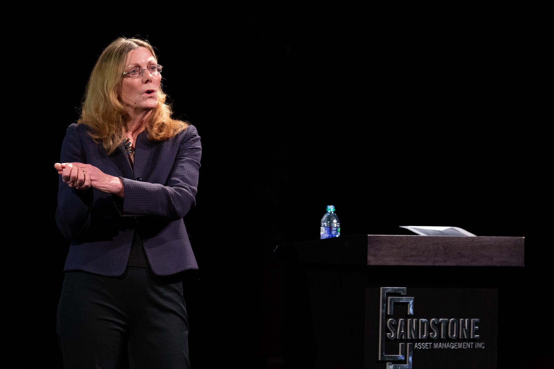 Sharon Watkins speaking on stage at OUTLOOK 2019